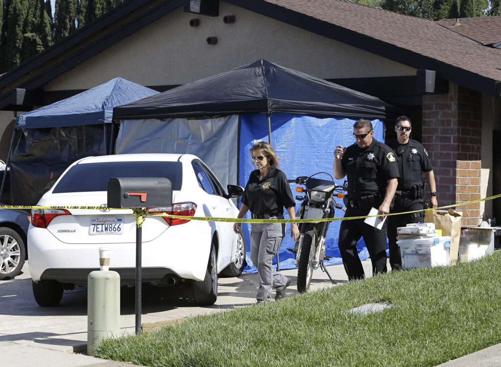 Sacramento County Sheriffs deputies leave the Citrus Heights, Calif., home of Joseph James DeAngelo, Wednesday, April 25 2018, who was a arrested on suspicion in a string of violent crimes in the 1970s and 1980s.