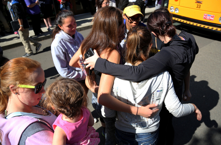 Friends and family are reunited with students at the local fairgrounds after a mass shooting at Umpqua Community College, in Roseburg, Thursday, Oct. 1, 2015. Multiple people were killed after a gunman opened fire at the campus early Thursday.
