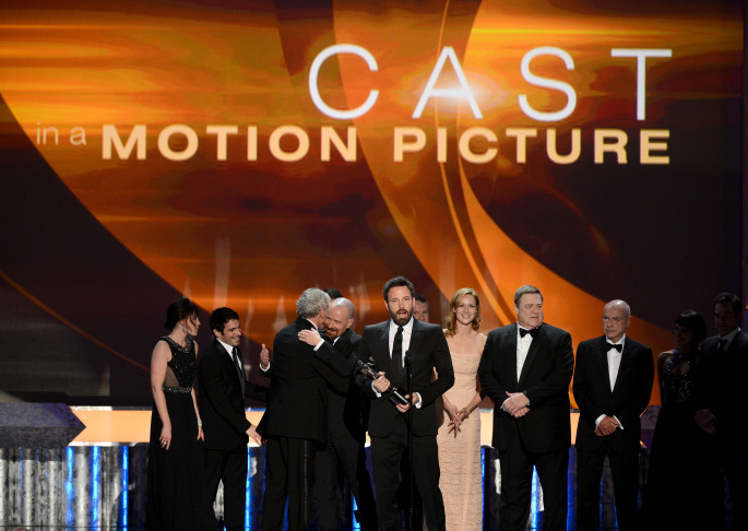 (L-R) Actors Jeremy Renner, Elisabeth Rohm, Bradley Cooper, Jennifer Lawrence and Amy Adams accept the Outstanding Performance by a Cast in a Motion Picture award for 'American Hustle' onstage during the 20th Annual Screen Actors Guild Awards at The Shrine Auditorium on Jan. 18, 2014 in Los Angeles.
