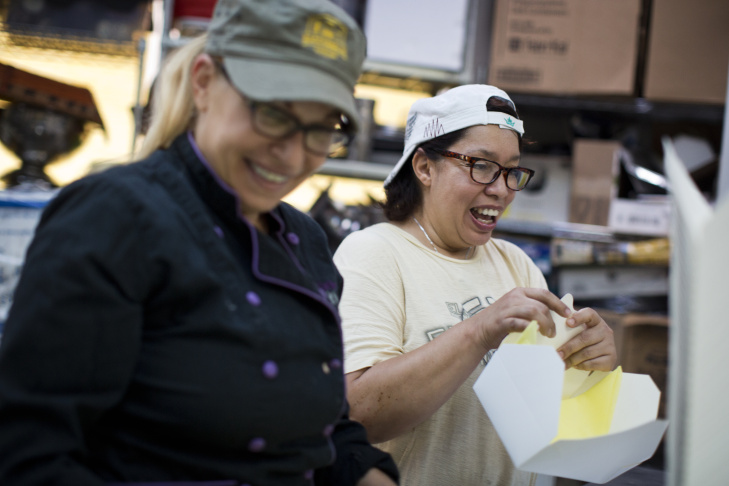 Grub co-owner Betty Fraser, left, and server Sylvia Quintanilla prepare boxes for next day's catering lunch order on Wednesday, June 10, 2015 at Grub's catering kitchen in Hollywood.