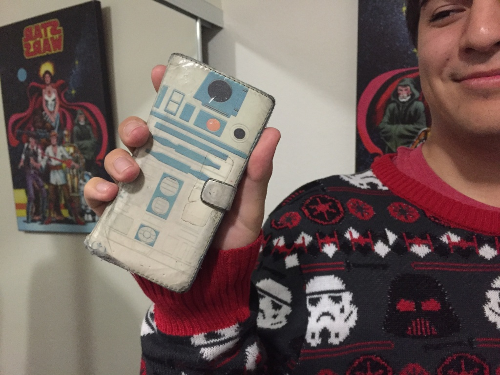 Superfan Robert Colter had no shortage of series related merchandise, including this R2-D2 phone case.