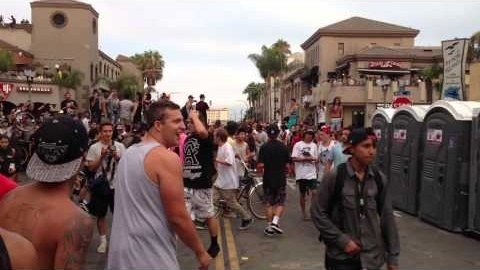 Huntington Beach plans to ask a judge Wednesday to stop a beach dance party planned for Saturday. (Photo: A couple of altercations on Main Street in Huntington Beach escalated into rowdiness with multiple fights, public property destruction and alleged stabbings following the end of the U.S. Open of Surfing event in July.)