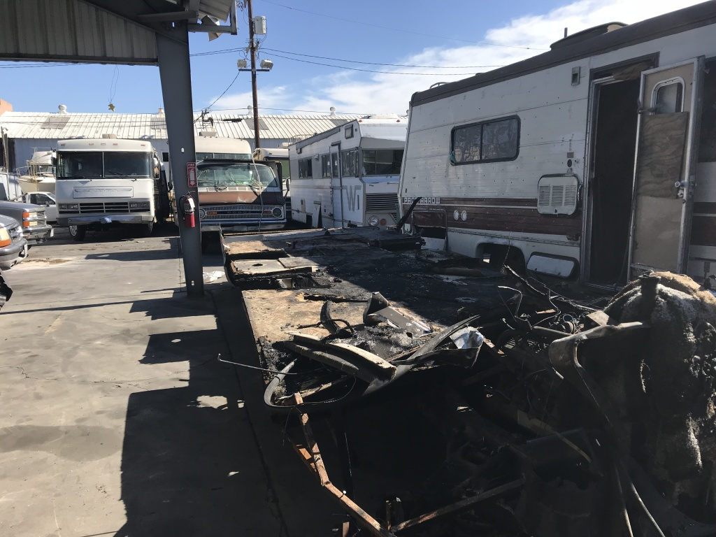 The company tows in two to three charred RV's each month, like this one from the San Fernando Valley.