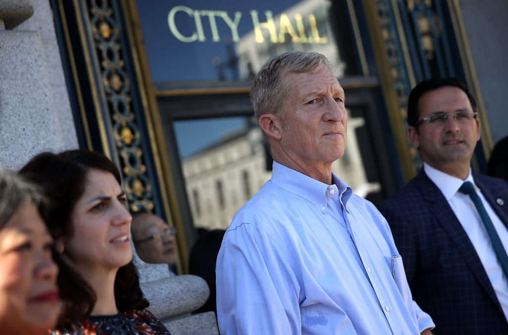 Billionaire Tom Steyer (C) looks on during a rally and press conference at San Francisco City Hall on October 24, 2017 in San Francisco, California. Tom Steyer spoke at a rally and press conference with San Francisco supervisor Sandra Lee Fewer who is the author of a resolution calling on U.S. Congress to initiate impeachment proceedings for U.S. president Donald Trump. Steyer has launched his own $10 million campaign calling on the impeachment of the president.
