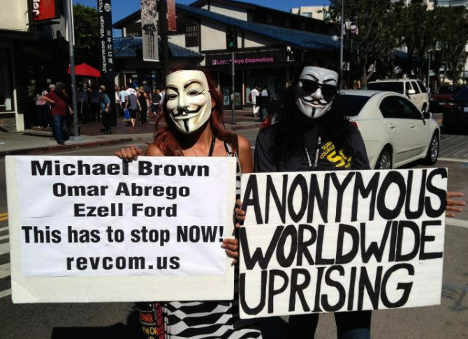 Protesters gather in front of Los Angeles Police headquarters in downtown L.A. on Sunday, August 17, 2014 to protest the shooting death of Ezell Ford by Los Angeles police.