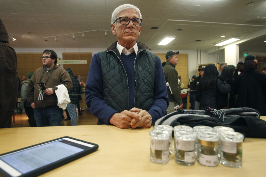A customer, who declined to give his name, waits for his order to be filled at Harborside marijuana dispensary, Monday, Jan. 1, 2018, in Oakland, Calif.