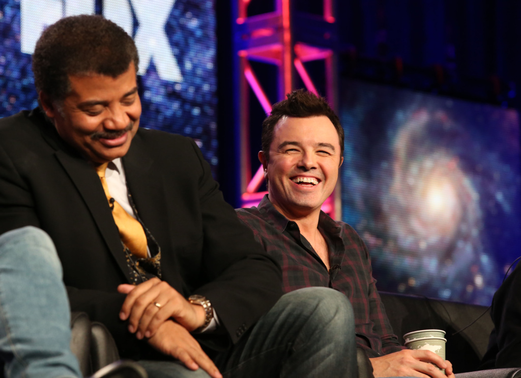 PASADENA, CA - JANUARY 13: Neil DeGrasse Tyson (L) and executive producer Seth MacFarlane speak during the FOX portion of the 2014 Television Critics Association Press Tour at the Langham Hotel on January 13, 2014 in Pasadena, California.  (Photo by Frederick M. Brown/Getty Images)