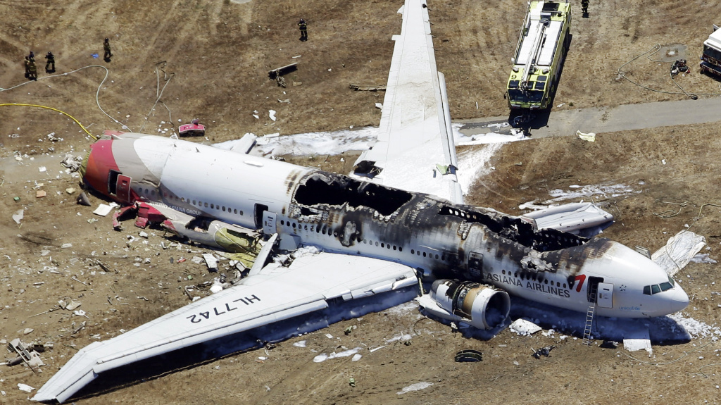 The wreckage of Asiana Flight 214, a Boeing 777 airliner, is seen after it crashed at the San Francisco International Airport Saturday.