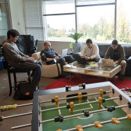 Google Software Engineers, from left, Keith Ito, Nicholas Lee, John Leen and Yatin Chawathe work in a room with a view and a foosball table at the newly opened of Google Kirkland October 28, 2009 in Kirkland, Washington.