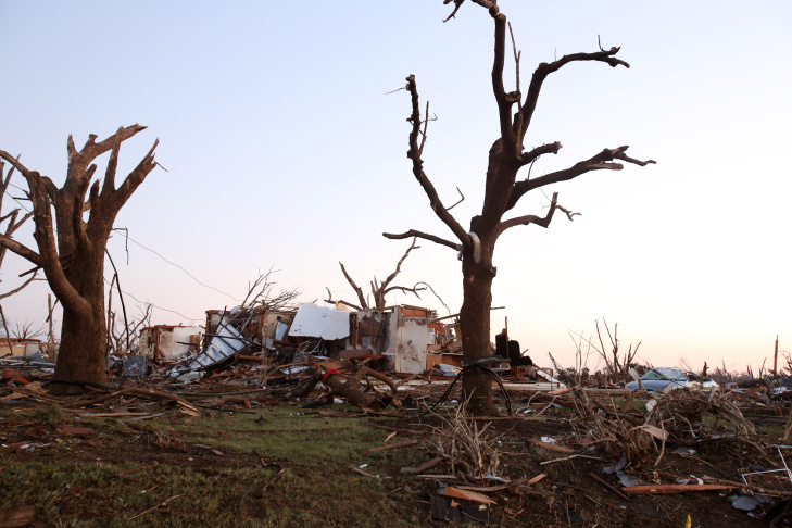 WASHINGTON, IL - NOVEMBER 17: Residents of Elgin Avenue sort through debris after a tornado struck on November 17, 2013 in Washington, Illinois. Several tornadoes touched down across the Midwest today with at least three people reported dead in Illinois. (Photo by Tasos Katopodis/Getty Images)