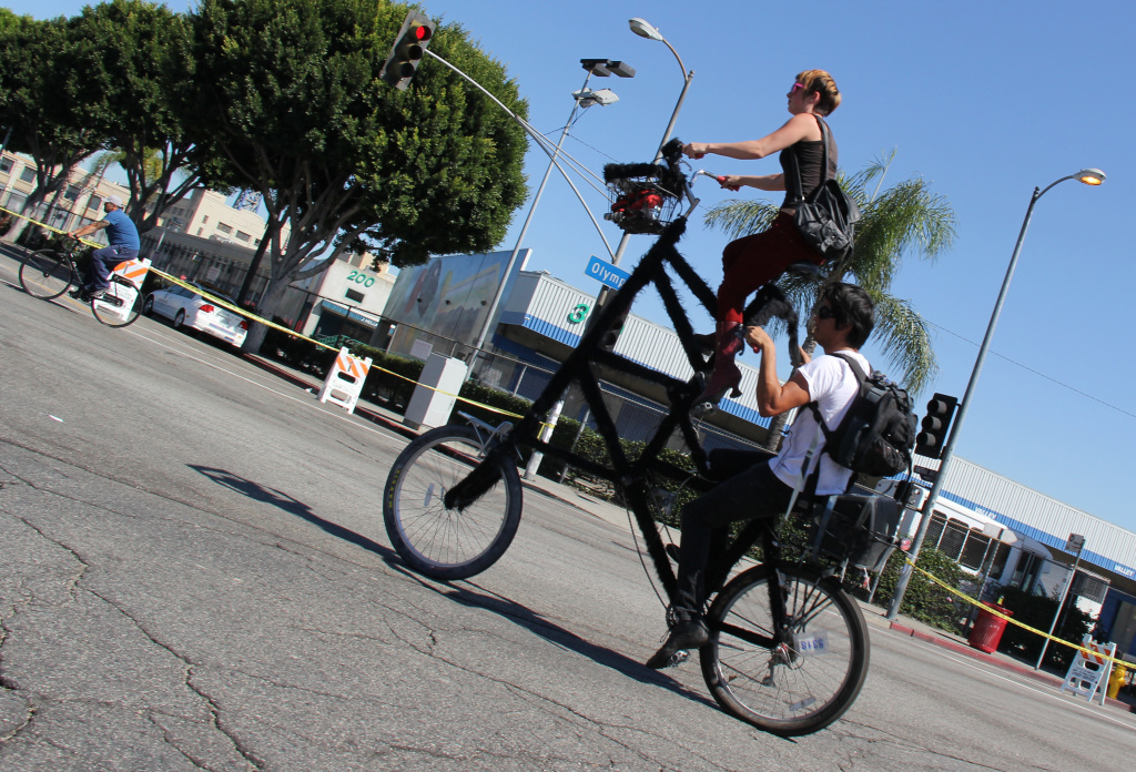 A double decker bike turns onto 9th Street at L.A.'s third CicLAvia event on October 9, 2011.