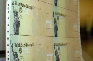 Treasury checks are run through a printer at the U.S. Treasury printing facility in Philadelphia, Pennsylvania.