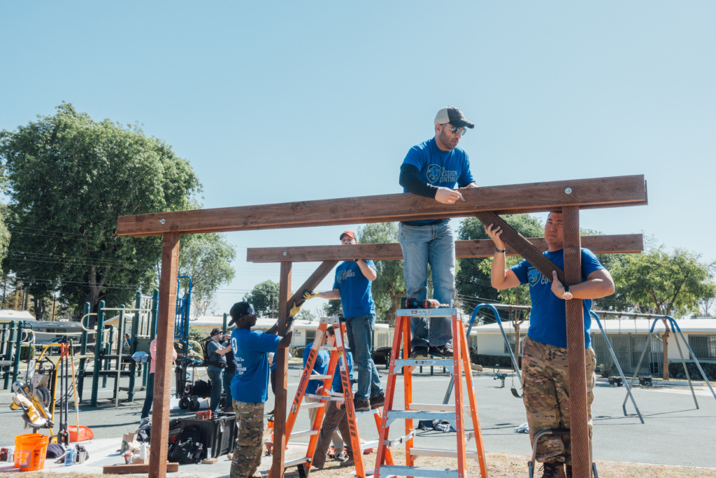 Kids playing at Gonzaque Village in Watts will have a new shade structure thanks to volunteers with The Mission Continues, a military veteran service organization.