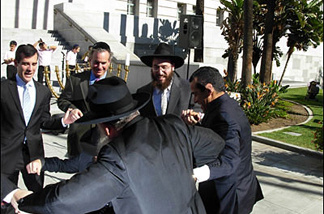 A few years ago, City Councilmen Garcetti and Weiss and Mayor Villaraigosa celebrate with rabbis from Chabad on the first day of Hanukkah.