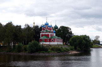 A day after leaving Moscow by cruise, travelers can see colorful churches along the forested banks of the Volga River. They share the banks with mansions of Russia's nouveau riche.
