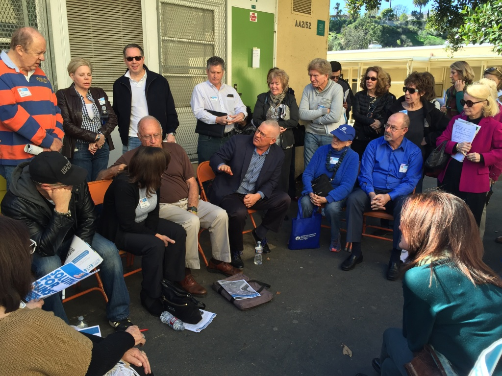 Los Angeles City Councilman Mike Bonin, center, meets with Brentwood residents frustrated by the increasing traffic on Sunset Boulevard near the I-405.