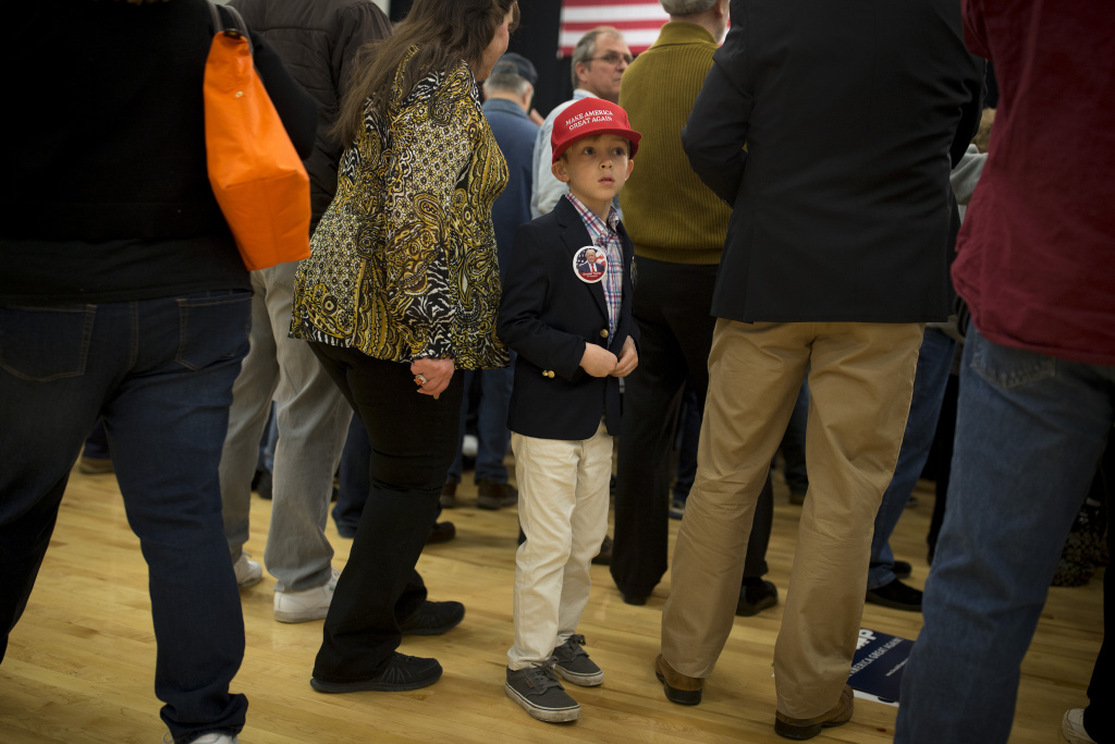 A boy waits for Republican presidential candidate Donald Trump to speak at a rally February 19, 2016 in Myrtle Beach, South Carolina.