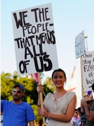 Actress Amber Heard holds a protest sign during a same-sex marriage demonstration in Los Angeles, California.