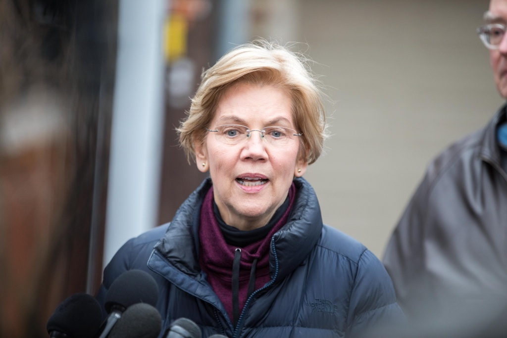 Sen. Elizabeth Warren (D-MA), addresses the media outside of her home after announcing she formed an exploratory committee for a 2020 Presidential run on December 31, 2018 in Cambridge, Massachusetts.