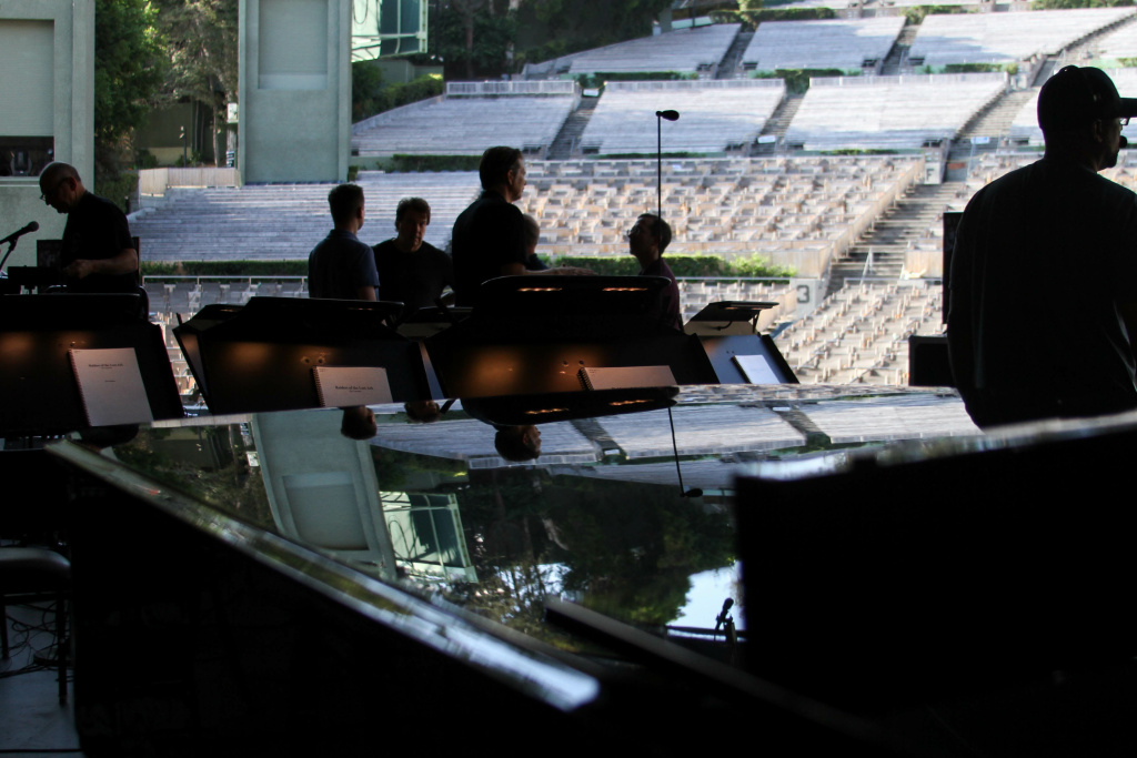 Sound engineers and performers prepare for rehearsal at the Hollywood Bowl on Aug. 4, 2017.