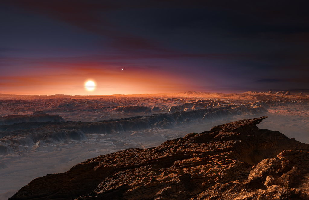 A hand out image made available by the European Southern Observatory on August 24 2016, shows an artist's impression of a view of the surface of the planet Proxima b orbiting the red dwarf star Proxima Centauri, the closest star to the Solar System.