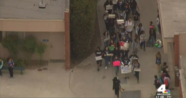 Students marching at Los Angeles-area Mayfair high School on Friday, Oct. 17 after a noose was found hanging on campus, as seen in an NBC L.A. screenshot.