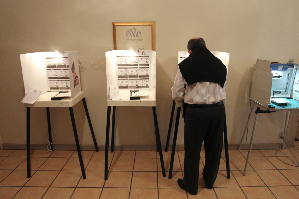 FILE PHOTO: A man marks his ballot during a local mayoral election on May 21, 2013 in Los Angeles. Officials expect Tuesday's local election will have one of the lowest turnouts in history.