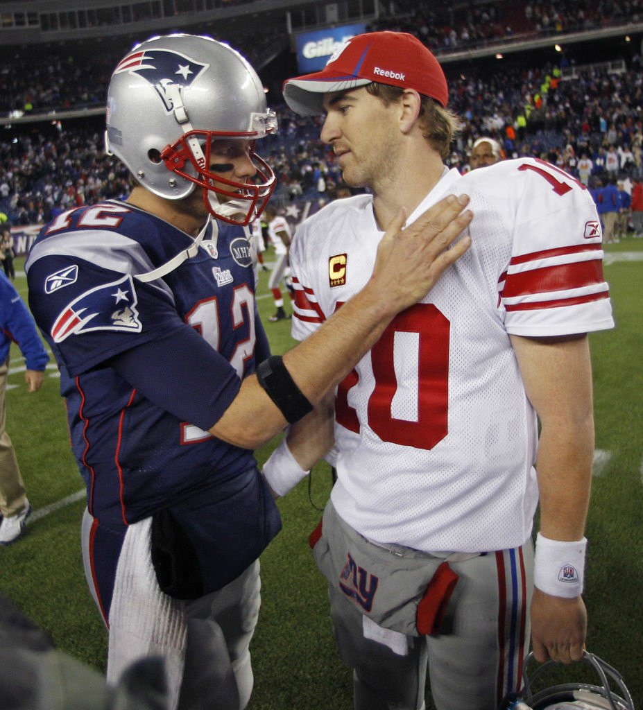 In this Nov. 6, 2011 file photo, New York Giants' Eli Manning, right, is congratulated by New England Patriots' Tom Brady after the Giants' 24-20 win in an NFL football game in Foxborough, Mass.