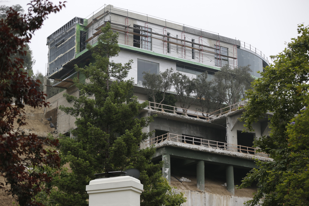A 30,000-square-foot structure is seen unfinished in Los Angeles Wednesday, May. 31, 2017. Mohamed Hadid, a developer of luxury homes has pleaded no contest in Los Angeles to misdemeanor charges stemming from construction of this Bel Air mansion that the city says has extensive features that were never approved. City officials ordered work on the gigantic home stopped three years ago amid claims by neighbors below that the hillside above their homes had been destabilized.