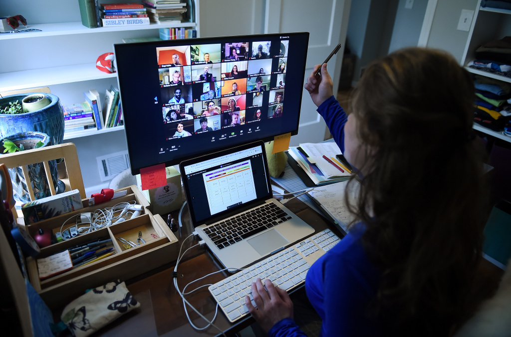 A teacher works from her home, working with her students through Zoom, due to the Coronavirus outbreak.