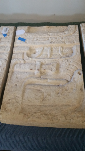 This is one of a set of three column-like limestone pieces that display Mayan hieroglyphic text. Dated by experts between 600-900 A.D., the sectioned slabs appear to have been the frame of the door when assembled.