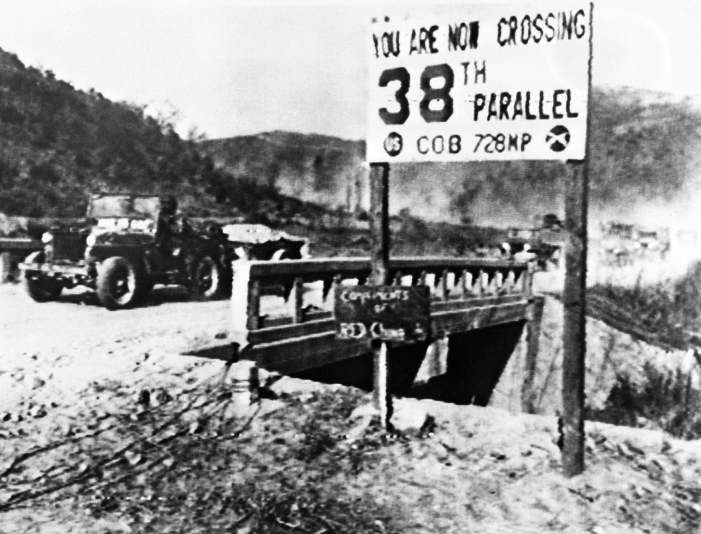 File: A jeep of the United Nations forces withdrawing from Pyongyang, the North Korean capital, recrosses the 38th parallel in December 1950. The Korean War between armies from North Korea and from South Korea lasted from June 25, 1950 to July 27, 1953.