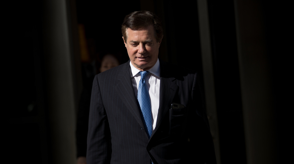 Paul Manafort exits the E. Barrett Prettyman Federal Courthouse in Washington, D.C., in February. On Friday, Manafort pleaded guilty and agreed to work with special counsel Robert Mueller.
