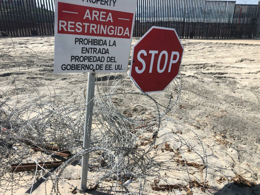 Concertina wire installed by U.S. Marines remains on the beach near the U.S.-Mexico border fence in San Diego.
