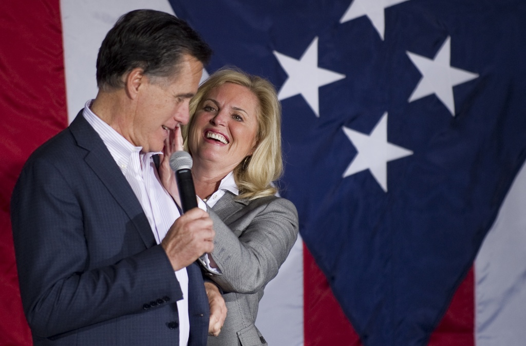 Ann Romney (R) wipes lipstick off Republican presidential candidate Mitt Romney's cheek as he prepares to speak at a rally in Zanesville, Ohio, March 5, 2012, ahead of voting on Super Tuesday.