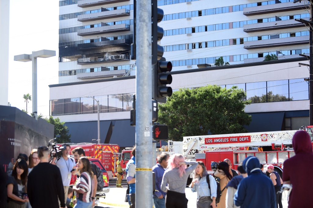 People stand outside the building after a fire at Barrington Plaza on January 29, 2020 in Los Angeles, California.