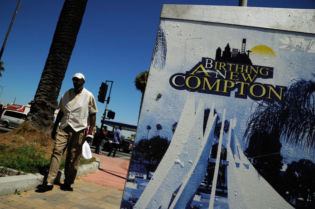 File: People walk past Compton City Hall.