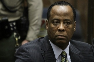Dr. Conrad Murray sits in court at his arraignment at Superior Court in Los Angeles, California.