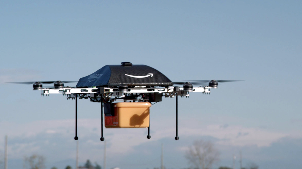 An Amazon Prime Air drone carries a package in an image taken of a test flight. The online retailer could begin 30-minute deliveries within four to five years, CEO Jeff Bezos told <em>60 Minutes</em> Sunday.