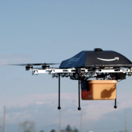 An Amazon Prime Air drone carries a package in an image taken of a test flight. The online retailer could begin 30-minute deliveries within four to five years, CEO Jeff Bezos told 60 Minutes Sunday.
