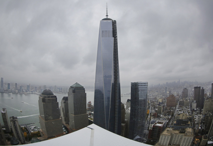 This combination made from file photos shows Willis Tower, formerly known as the Sears Tower, in Chicago on March 12, 2008, left, and 1 World Trade Center in New York on Sept. 5, 2013. The new World Trade Center tower in New York knocked Chicago's Willis Tower off its pedestal as the nation's tallest building when an international panel of architects announced Tuesday, Nov. 12, 2013, that the needle atop the skyscraper can be counted when measuring the structure's height.