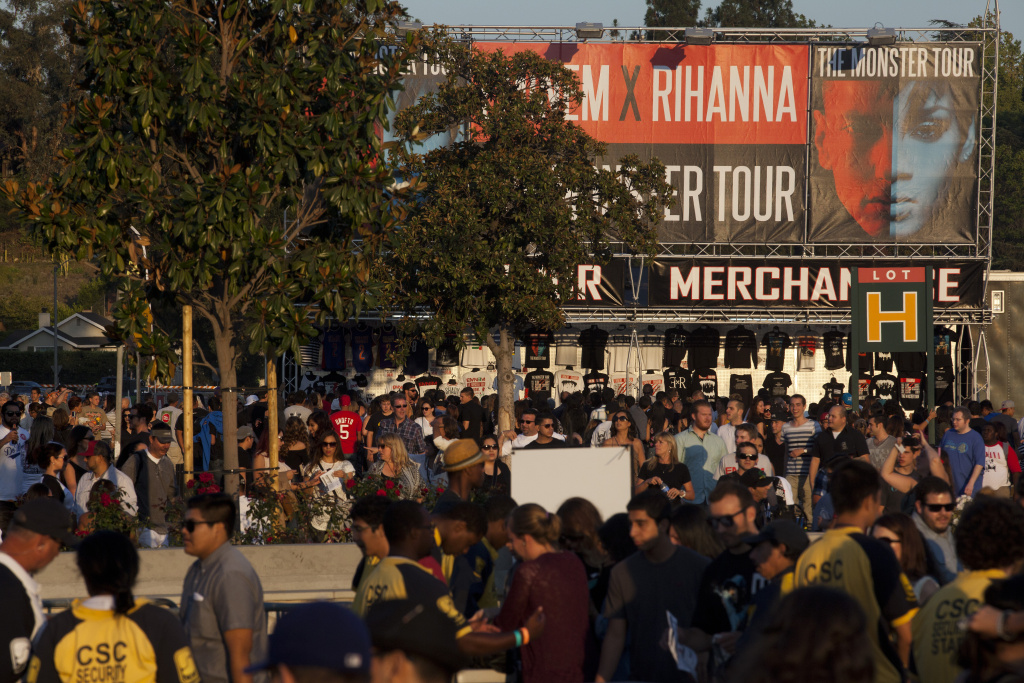 Fans flock to the Rose Bowl for an Eminem and Rihanna concert.
