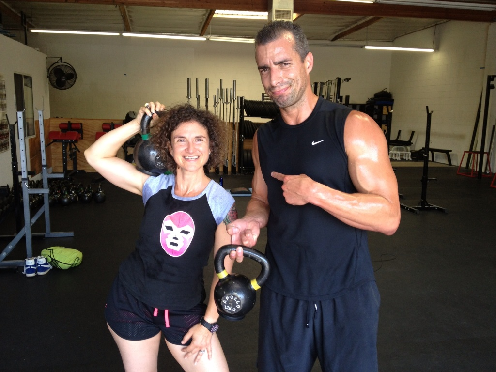 Take Two hosts Alex Cohen and A Martinez pose together after their CrossFit workout.