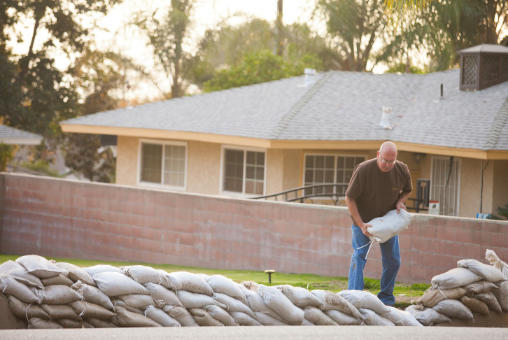Glendora resident Greg Williams, prepares for an upcoming storm onThursday, Dec. 11, 2014.