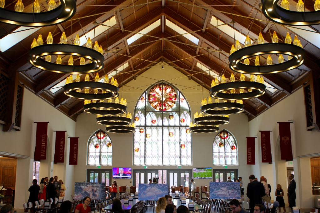 A giant new dining hall, with its high arched ceiling and stained glass, might remind students of where Harry Potter and his friends ate at Hogwarts.