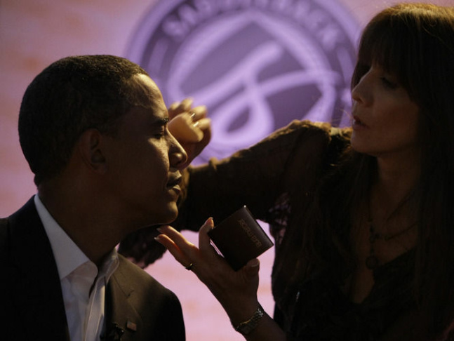 Then-Sen. Barack Obama gets makeup applied at a presidential candidate forum in Lake Forrest, Calif., on Aug. 16, 2008.