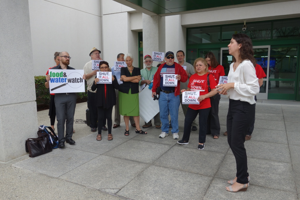 Members of Save Porter Ranch and Food & Water Watch and Consumer Watchdog gathered Aug. 26, 2016, at a state workshop on energy reliability to call for the Aliso Canyon Natural Gas Storage Facility to be shut down.