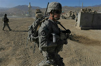 U.S. soldiers on patrol in Afghanistan's Wardak province. Afghan officials asked the Americans to leave the province on Sunday.