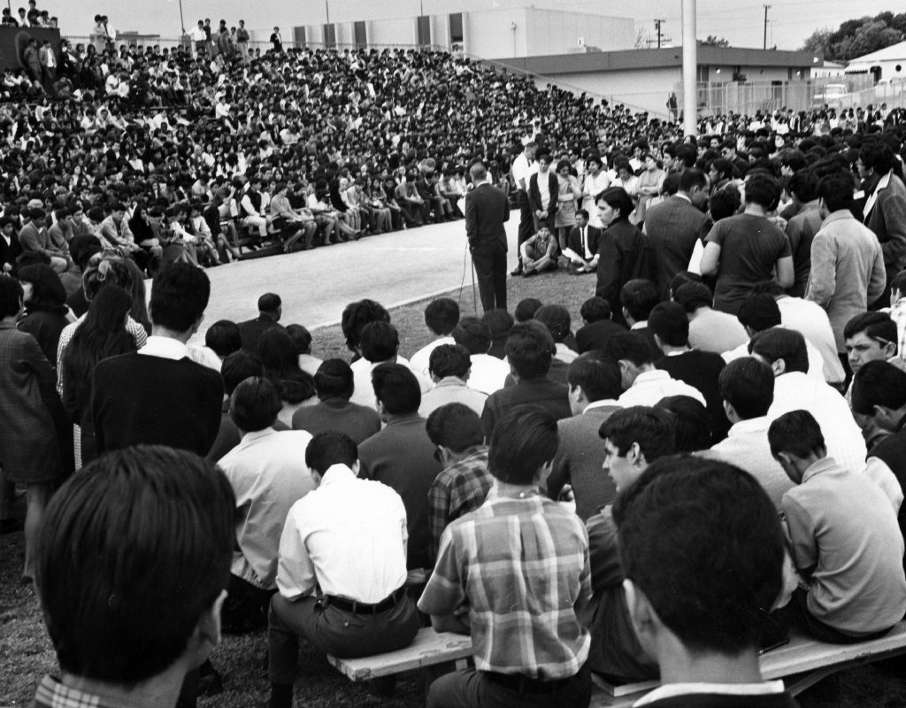 Garfield High School students gather for a special assembly on March 7, 1968, as principal Reginald Murphy (center) appeals to students to return to class.
