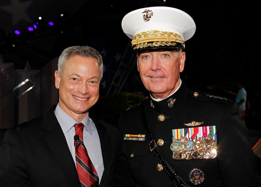 Actor Gary Sinise (L) and General Joseph F. Dunford, Jr., Chairman of the Joint Chiefs of Staff, pose for a photo backstage at the 27th National Memorial Day Concert on May 29, 2016 in Washington, DC.